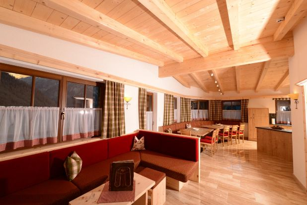 Chalet Sölden living room for 13 people kitchen and balcony couch with Flat TV