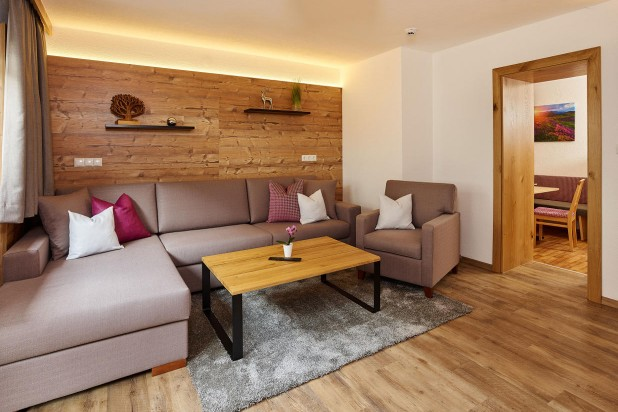 Apartment Sölden with private sauna living room with couch and kitchen